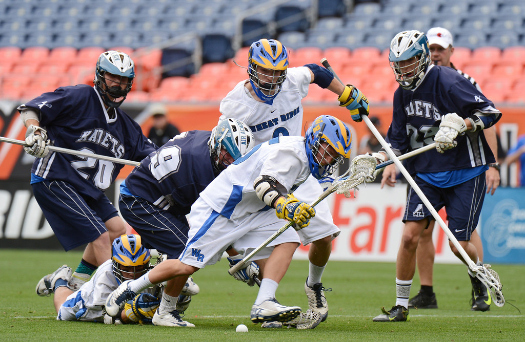 . DENVER, CO. - MAY 18 : Bennei Pachello of Wheat Ridge High School (15) is trying to control the free ball during 4A Boy\'s Lacrosse Championship game against Air Academy High School at Sports Authority Field at Mile High Stadium. Denver, Colorado. May 18, 2013. (Photo By Hyoung Chang/The Denver Post)