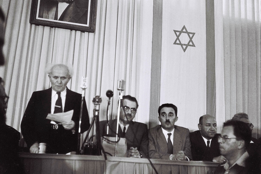 . TEL AVIV, ISRAEL - MAY 14:  In this handout from the GPO, David Ben Gurion, who was to become Israel\'s first Prime Minister, reads the Declaration of Independence May 14, 1948 at the museum in Tel Aviv, during the ceremony founding the State of Israel. (Photo by Zoltan Kluger/GPO via Getty Images)