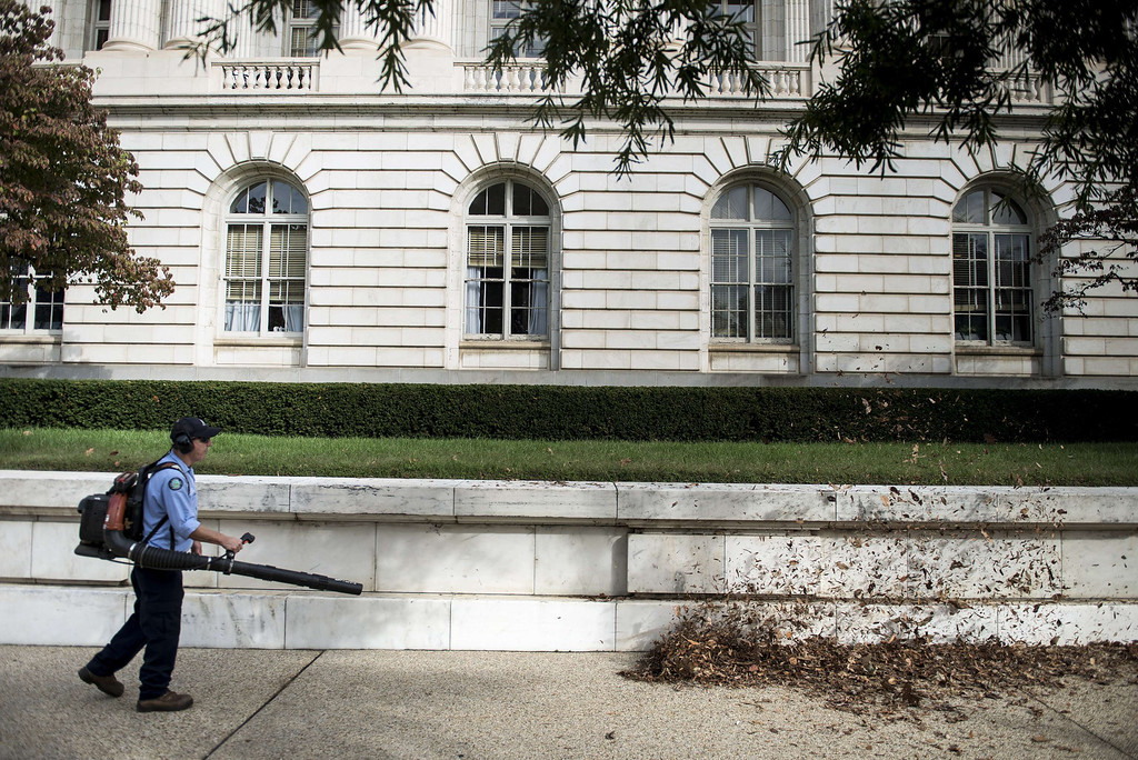 . A worker cleans leaves from the Russell Senate Office Building on Capitol Hill October 17, 2013 in Washington, DC. The US federal government reopened today after a 16 day forced shutdown. AFP PHOTO/Brendan SMIALOWSKI/AFP/Getty Images