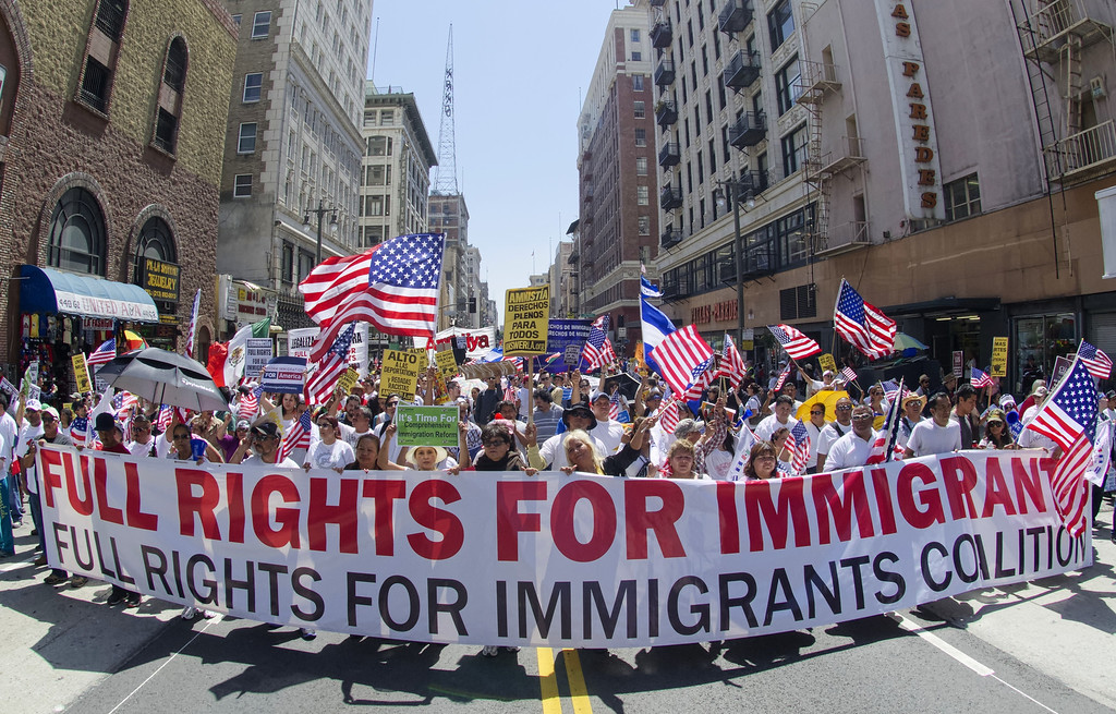 . Demonstrators seeking  change in immigration policy march on May Day in Los Angeles, California, May 01, 2013. Some 2,000 demonstrators marched in  May Day rallies calling for immigration reform, a key issue just north of the US-Mexican border.   JOE KLAMAR/AFP/Getty Images