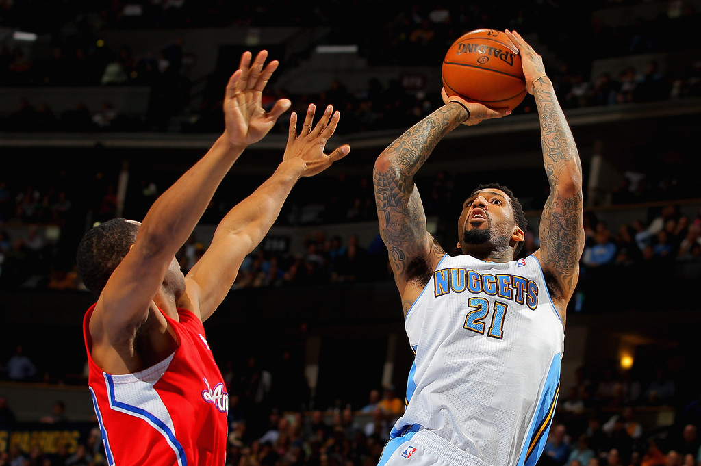 . DENVER, CO - MARCH 07:  Wilson Chandler #21 of the Denver Nuggets takes a shot against the Los Angeles Clippers at the Pepsi Center on March 7, 2013 in Denver, Colorado.   (Photo by Doug Pensinger/Getty Images)