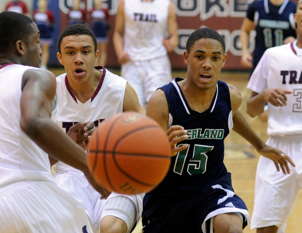 . Overland guard Austin Conway (15) lost the ball out of bounds in the second half. The Cherokee Trail boy\'s basketball team defeated Overland 59-57 Friday night, January 11, 2013. Karl Gehring/The Denver Post
