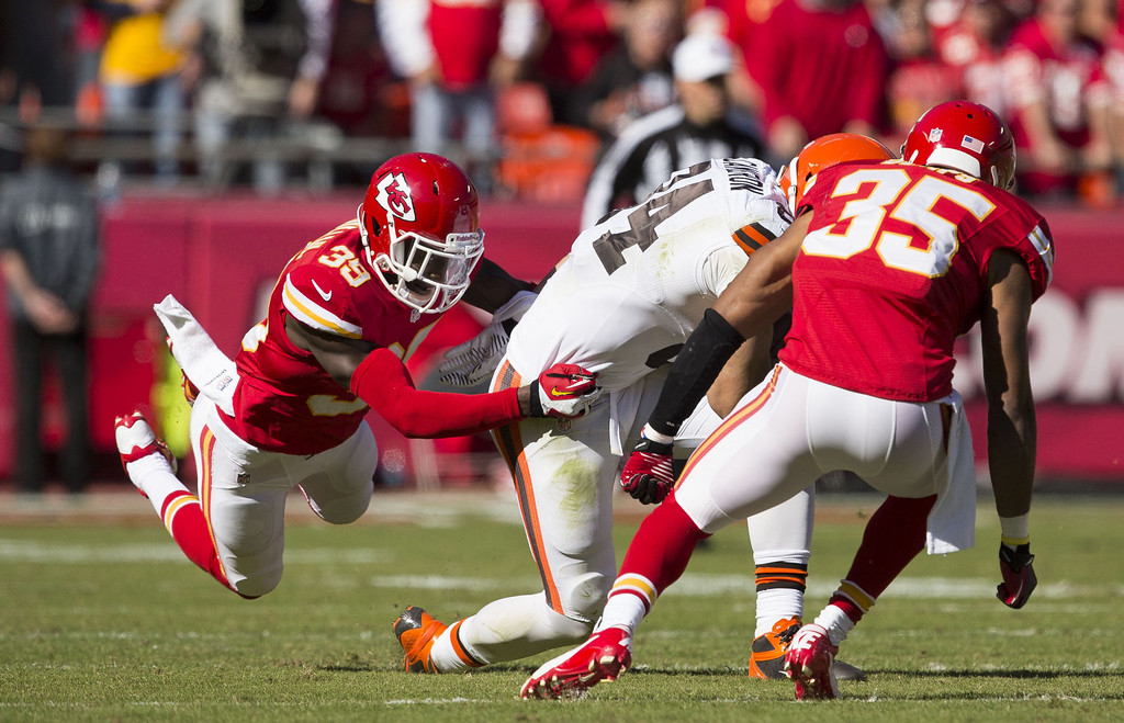 . Defensive back Husain Abdullah #39 of the Kansas City Chiefs tackles tight end Jordan Cameron #84 of the Cleveland Browns during the game at Arrowhead Stadium on October 27, 2013 in Kansas City, Missouri. (Photo by David Welker/Getty Images)