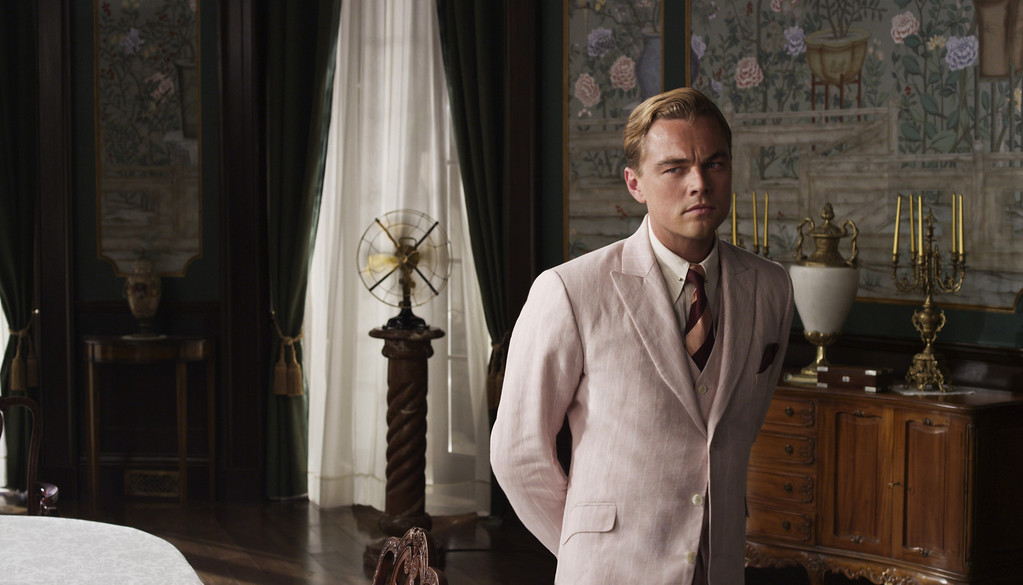 ". LEONARDO DiCAPRIO as Jay Gatsby in Warner Bros. Pictures� and Village Roadshow Pictures� drama  ""THE GREAT GATSBY,\"" a Warner Bros. Pictures release.��®"