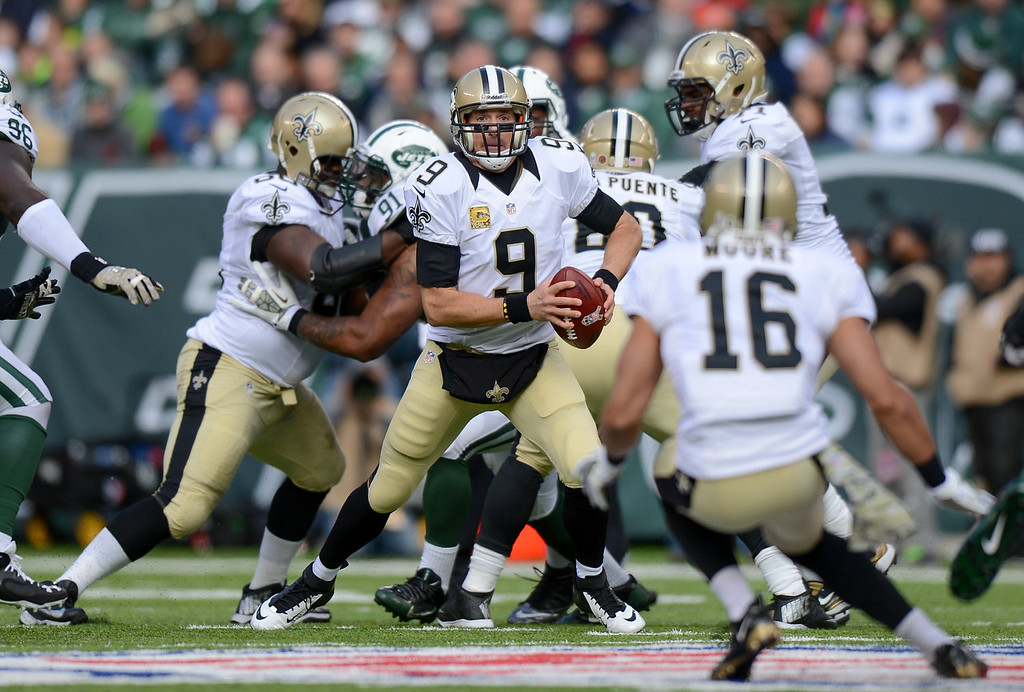 . Quarterback Drew Brees #9 of the New Orleans Saints scrambles in the 1st  quarter against the New York Jets at MetLife Stadium on November 3, 2013 in East Rutherford, New Jersey. (Photo by Ron Antonelli/Getty Images)