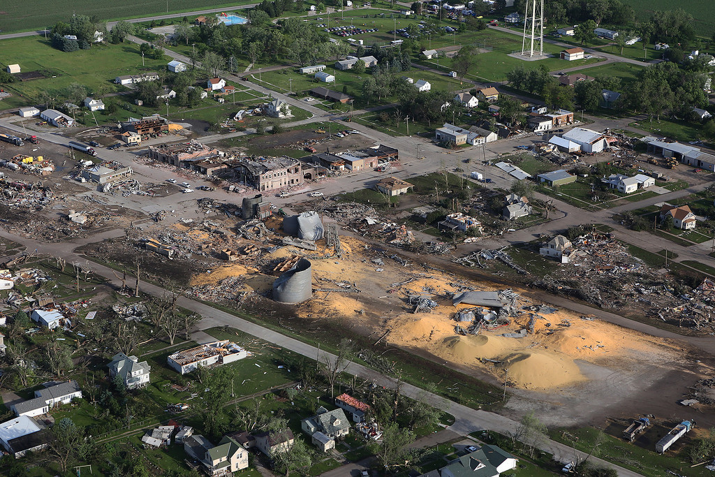 . This Tuesday, June 17, 2014, aerial photo shows the devastated town of Pilger, Neb.   (AP Photo/Dakota Aerials, Dave Tunge)