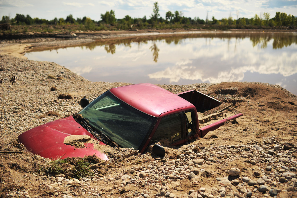. LONGMONT, CO - September 18 : A truck is encased in flood debris near the corner of 75th St. and Hygiene Rd. in Longmont, Colorado. September 18, 2013.  (Photo by Hyoung Chang/The Denver Post)