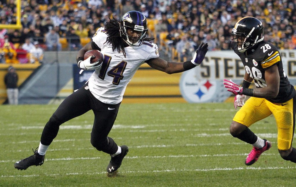 . Marlon Brown #14 of the Baltimore Ravens runs after making a catch against the Pittsburgh Steelers during the game on October 20, 2013 at Heinz Field in Pittsburgh, Pennsylvania.  (Photo by Justin K. Aller/Getty Images)