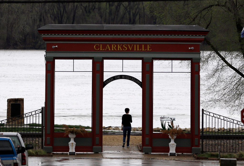 . A woman watches the rising Mississippi River Thursday, April 18, 2013, in Clarksville, Mo. The river was expected to climb nearly 10 feet above flood stage by the middle of next week several spots north of St. Louis, including tiny Clarksville, Mo. (AP Photo/Jeff Roberson)