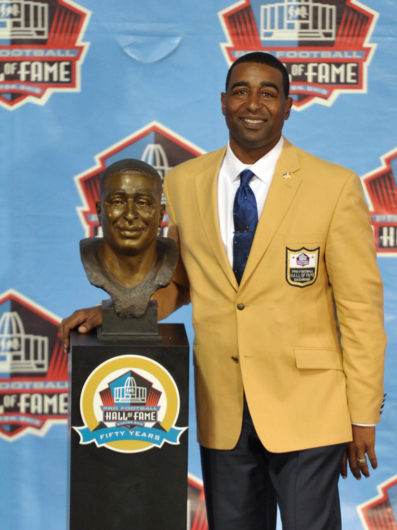 . Hall of Fame inductee Cris Carter poses with his bust during the 2013 Pro Football Hall of Fame Induction Ceremony Saturday, Aug. 3, 2013, in Canton, Ohio. (AP Photo/David Richard)