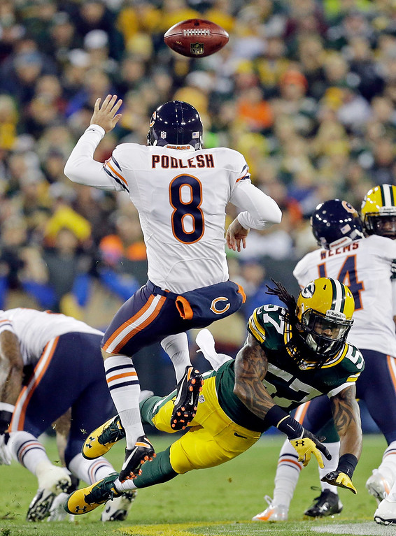 . Green Bay Packers\' Jamari Lattimore (57) blocks the punt of Chicago Bears\' Adam Podlesh (8) during the first half of an NFL football game Monday, Nov. 4, 2013, in Green Bay, Wis. (AP Photo/Mike Roemer)