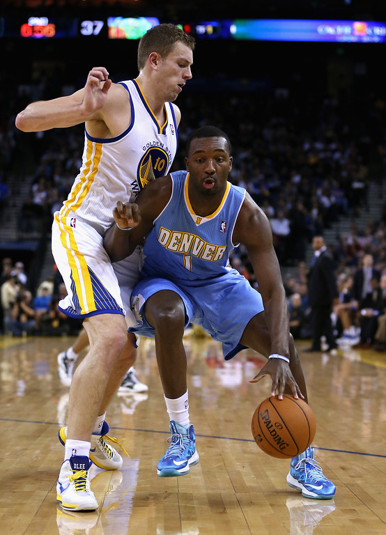 . OAKLAND, CA - NOVEMBER 29: Jordan Hamilton #1 of the Denver Nuggets drives on David Lee #10 of the Golden State Warriors at Oracle Arena on November 29, 2012 in Oakland, California. (Photo by Ezra Shaw/Getty Images)