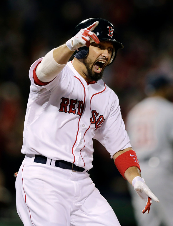 . Boston Red Sox\'s Shane Victorino celebrates his grand slam against the Detroit Tigers as he rounds first base in the seventh inning during Game 6 of the American League baseball championship series on Saturday, Oct. 19, 2013, in Boston. (AP Photo/Charles Krupa