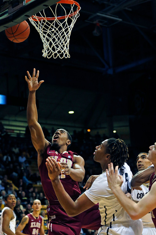. Elon\'s Kevin Blake shoots during an NCAA college basketball game against Colorado in Boulder, Colo., Friday, Dec. 13, 2013. (AP Photo/Brennan Linsley)