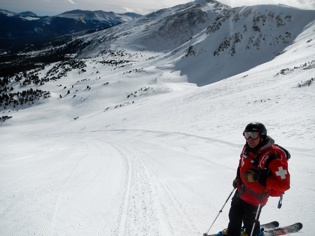 """. Snow Safety Supervisor Will Barrett samples the goods on \""""Bliss,\"""" the signature high-mountain intermediate slope opening as part of the 543-acre expansion onto Peak 6 at Breckenridge. Scott Willoughby, The Denver Post"""