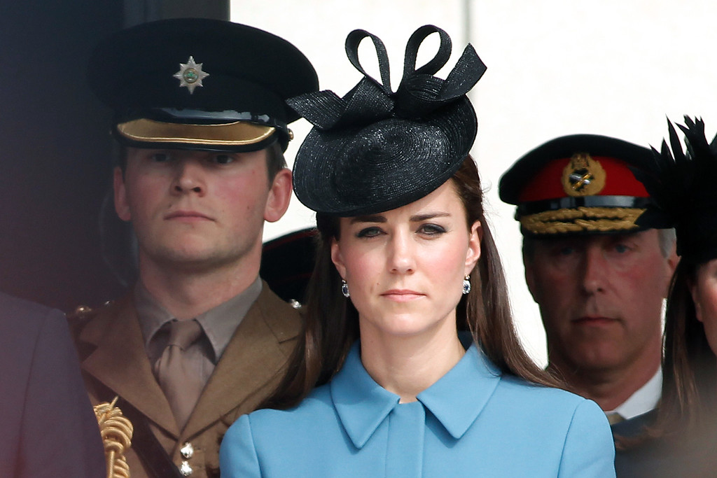 . Kate the Duchess of Cambridge attends a ceremony in honor of Britain\'s WWII veterans, as part of D-Day commemoration, in Arromanches, western France , Friday June 6, 2014. Gone are the screaming shells, seasick soldiers and bloodied waters of 1944. (AP Photo/Thibault Camus)