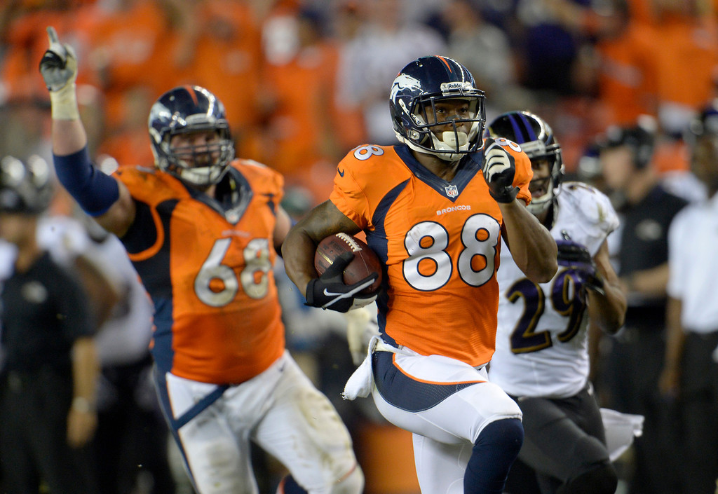 . DENVER, CO - SEPTEMBER 05: Denver Broncos wide receiver Demaryius Thomas (88) dashes for the end zone for a the seventh touchdown pass from quarterback Peyton Manning (18). Denver Broncos Baltimore Ravens September 5, 2013 at Sports Authority at Mile High. (Photo by Joe Amon/The Denver Post)