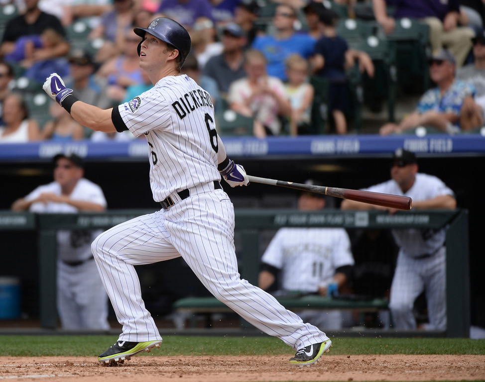 . DENVER, CO - JUNE 20: Colorado batter Corey Dickerson watched his home run ball head for the seats in the sixth inning. The Colorado Rockies hosted the Milwaukee Brewers at Coors Field Saturday afternoon, June 21, 2014. Photo by Karl Gehring/The Denver Post