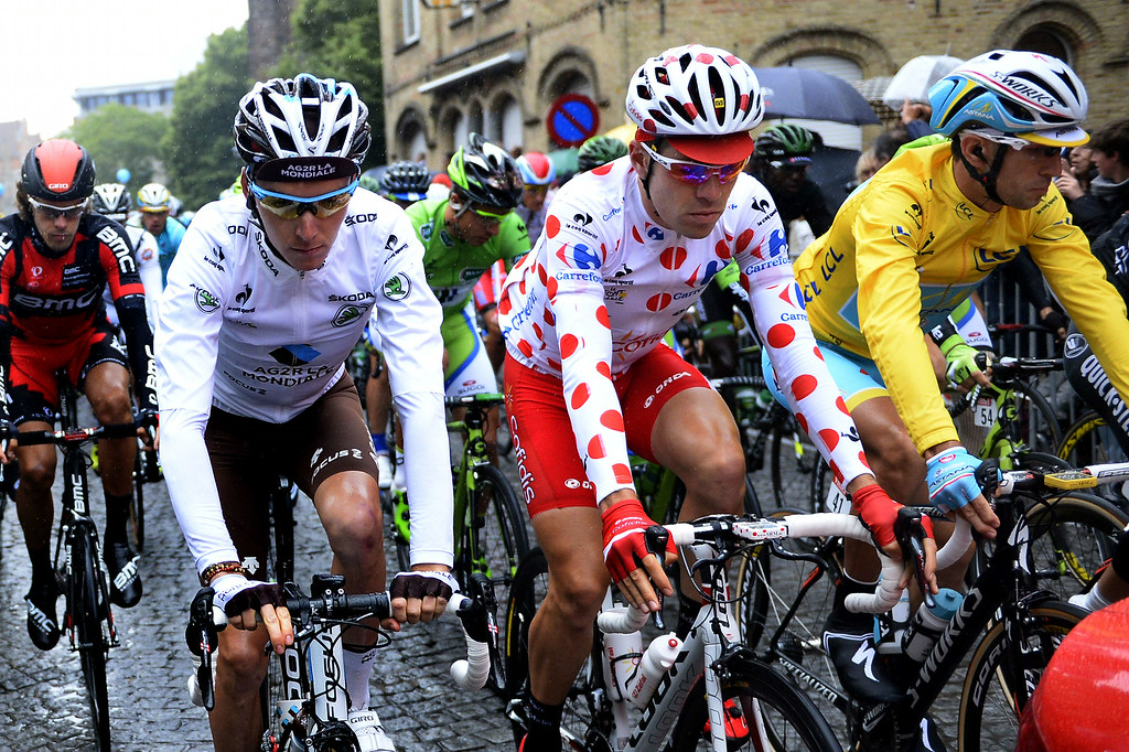 . (From L) France\'s Romain Bardet wearing the best young\'s white jersey, France\'s Cyril Lemoine wearing the best climber\'s polka dot jersey, and Italy\'s Vincenzo Nibali wearing the overall leader\'s yellow jersey take the start of the 152,5 fifth stage of the 101st edition of the Tour de France cycling race on July 9, 2014 between Ypres, northwestern Belgium, and Arenberg Porte du Hainaut in Wallers northern France.  AFP PHOTO / ERIC  FEFERBERG/AFP/Getty Images
