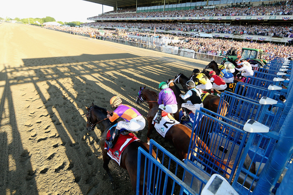 . ELMONT, NY - JUNE 07:  The field starts the 146th running of the Belmont Stakes at Belmont Park on June 7, 2014 in Elmont, New York.  (Photo by Rob Carr/Getty Images)