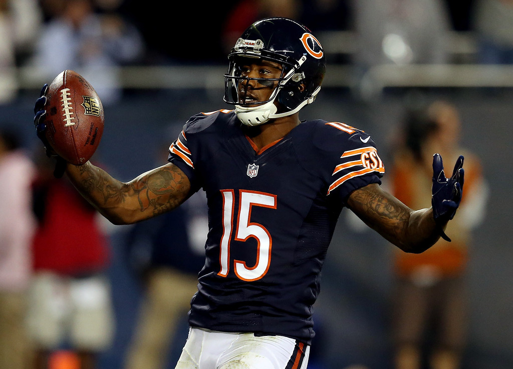 . Wide receiver Brandon Marshall #15 of the Chicago Bears celebrates a touchdown against the New York Giants during a game at Soldier Field on October 10, 2013 in Chicago, Illinois.  (Photo by Jonathan Daniel/Getty Images)