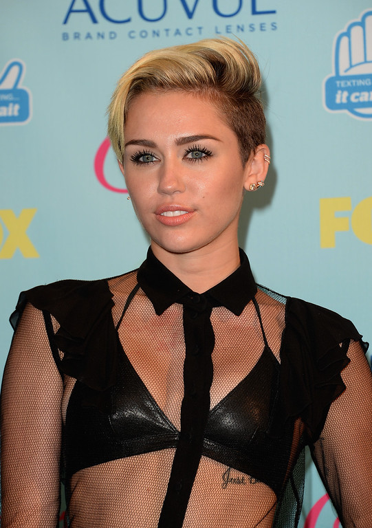 . Singer Miley Cyrus attends the Teen Choice Awards 2013 at Gibson Amphitheatre on August 11, 2013 in Universal City, California.  (Photo by Jason Merritt/Getty Images)