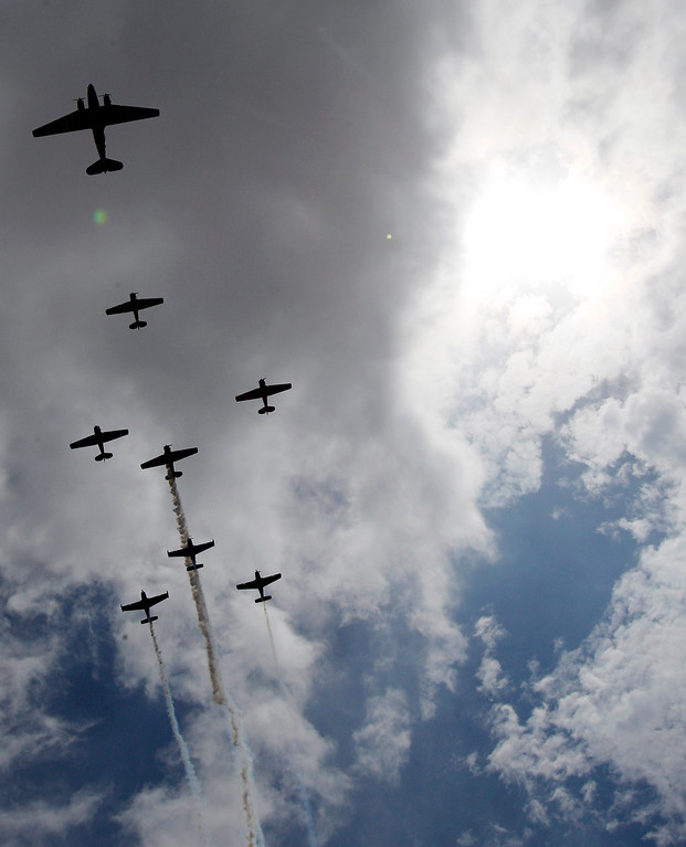 . Vintage planes from the Cavanaugh Flight Museum fly over Globe Life Park before an opening day baseball game between the Texas Rangers and the Philadelphia Phillies, Monday, March 31, 2014, in Arlington, Texas. (AP Photo/Kim Johnson Flodin)