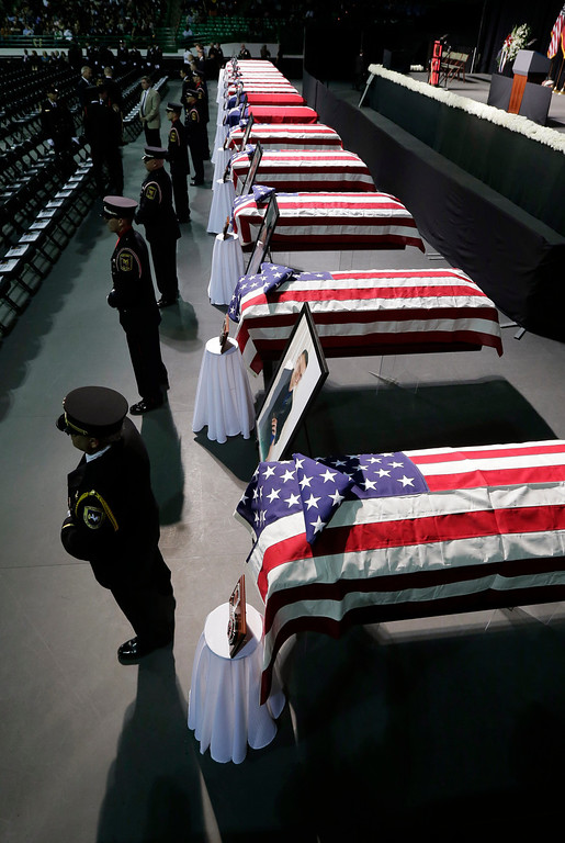 . Honor guard stand in front of caskets prior to a memorial service for first responders who died in last week\'s fertilizer plant explosion in West, Texas, Thursday, April 25, 2013, in Waco, Texas. (AP Photo/Eric Gay)