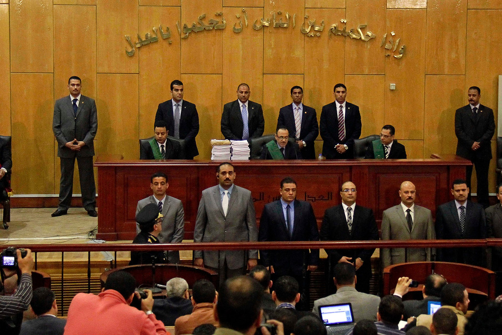 . Judges of the Port Said Criminal Court, holding a hearing in Cairo for security reasons, rules in the case of last year\'s soccer violence in Port Said which left over 70 dead in Cairo, Egypt, Saturday, March 9, 2013.  (AP Photo/Ahmed Abd El Latef, El Shorouk Newspaper)
