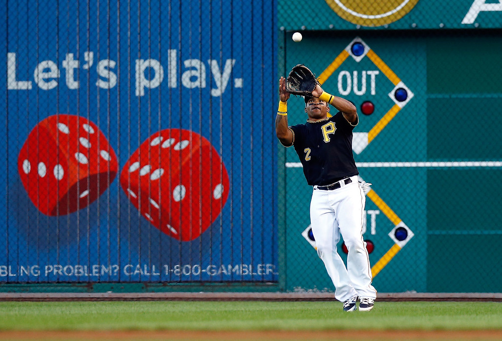 . Marlon Byrd #2 of the Pittsburgh Pirates catches a fly ball in the sixth inning against the St. Louis Cardinals during Game Three of the National League Division Series at PNC Park on October 6, 2013 in Pittsburgh, Pennsylvania.  (Photo by Jared Wickerham/Getty Images)
