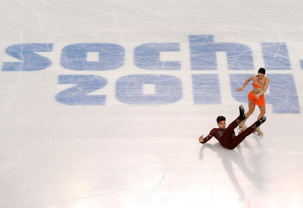 Description of . Nicole Della Monica and Matteo Guarise of Italy during the Pairs Short Program of the Figure Skating event at Iceberg Palace during the Sochi 2014 Olympic Games, Sochi, Russia, 11 February 2014.  EPA/HOW HWEE YOUNG