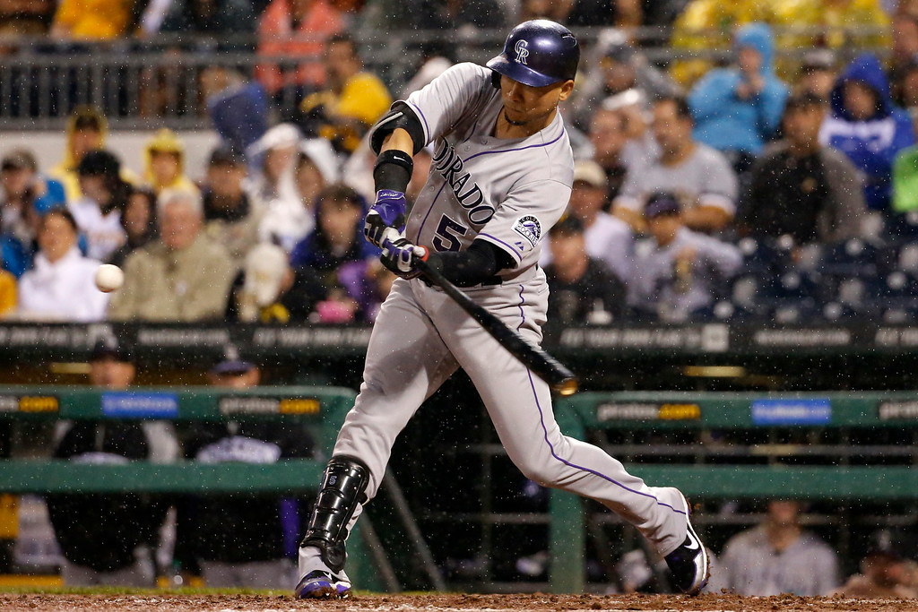 . Colorado Rockies\' Carlos Gonzalez (5) hits a two run home run off Pittsburgh Pirates starting pitcher Charlie Morton during the seventh inning of a baseball game in Pittsburgh Saturday, July 19, 2014. (AP Photo/Gene J. Puskar)