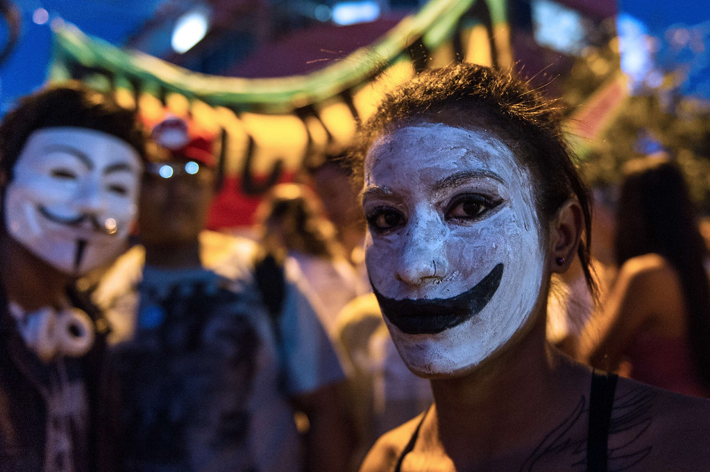. A made-up woman is seen during a demonstration in Belo Horizonte, Brazil, on June 21, 2013. Brazil\'s embattled president Dilma Rousseff was to address the nation late Friday, a day after more than one million people marched to demand better living conditions, her office said. AFP PHOTO / YASUYOSHI  CHIBA/AFP/Getty Images