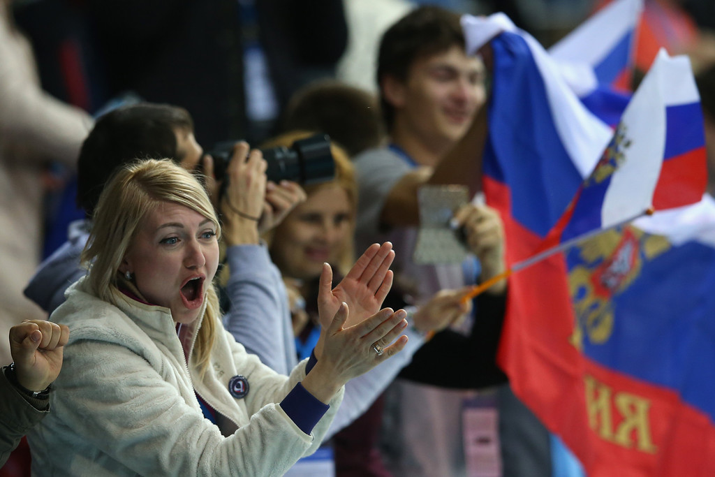 . SOCHI, RUSSIA - FEBRUARY 13:  Russian fans show their support during the Curling Round Robin match between Russia and Switzerland during day six of the Sochi 2014 Winter Olympics at Ice Cube Curling Center on February 13, 2014 in Sochi, Russia.  (Photo by Julian Finney/Getty Images)