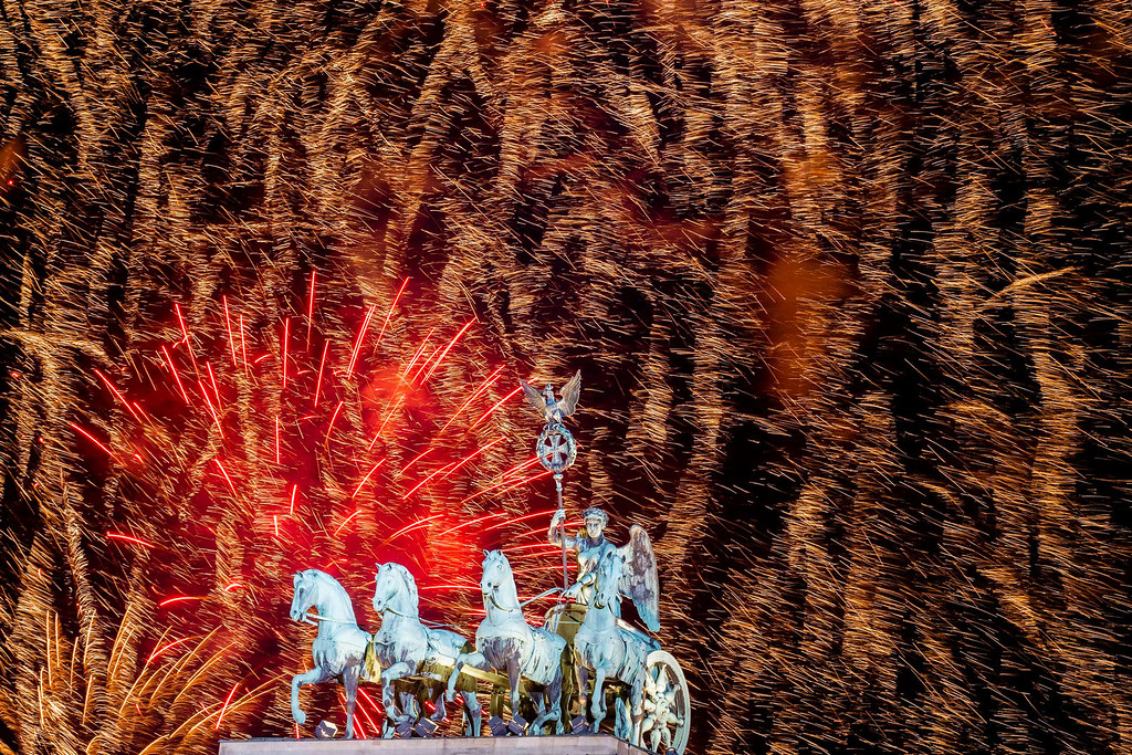 . Fireworks explode in the sky above the  Quadriga on the Brandenburg Gate during the New Year\'s celebrations in Berlin, Tuesday, Jan. 1, 2013. (AP Photo/Markus Schreiber)