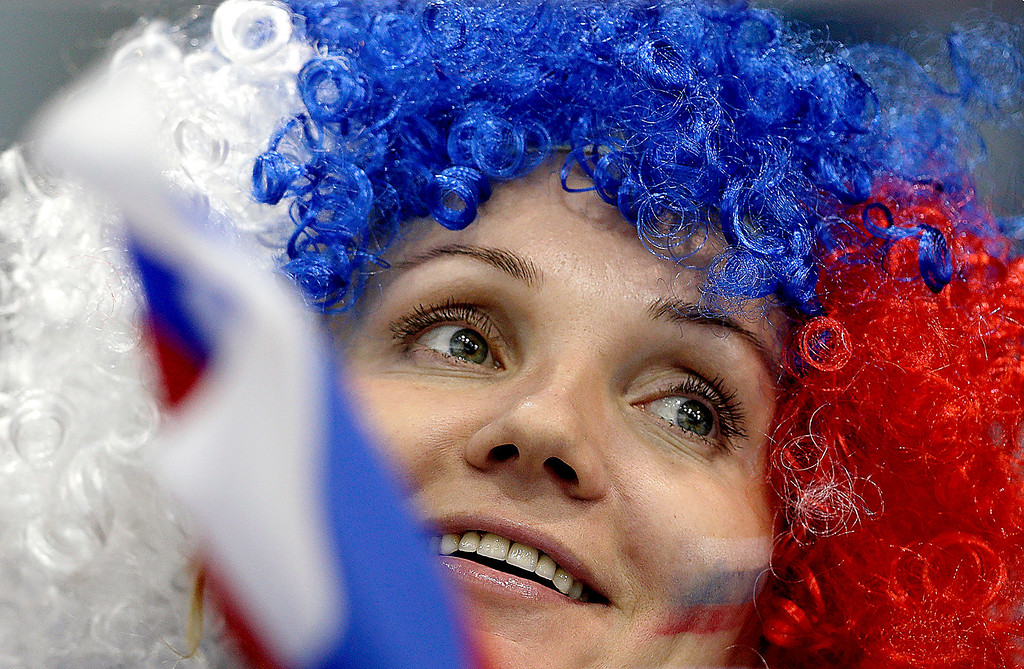 . A supporter of the Russian team wears a wig in the colors of the Russian national flag during the men\'s curling competition at the 2014 Winter Olympics, Monday, Feb. 10, 2014, in Sochi, Russia. (AP Photo/Wong Maye-E)