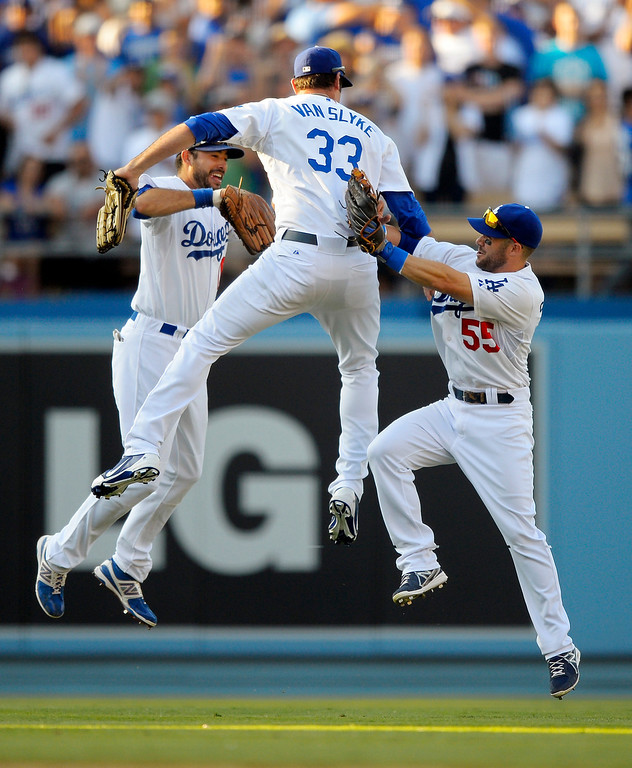 . Los Angeles Dodgers\' Andre Ethier, left, Scott Van Slyke, center, and Skip Schumaker celebrate after the Dodgers defeated the Colorado Rockies 1-0 in a baseball game, Saturday, July 13, 2013, in Los Angeles. (AP Photo/Mark J. Terrill)
