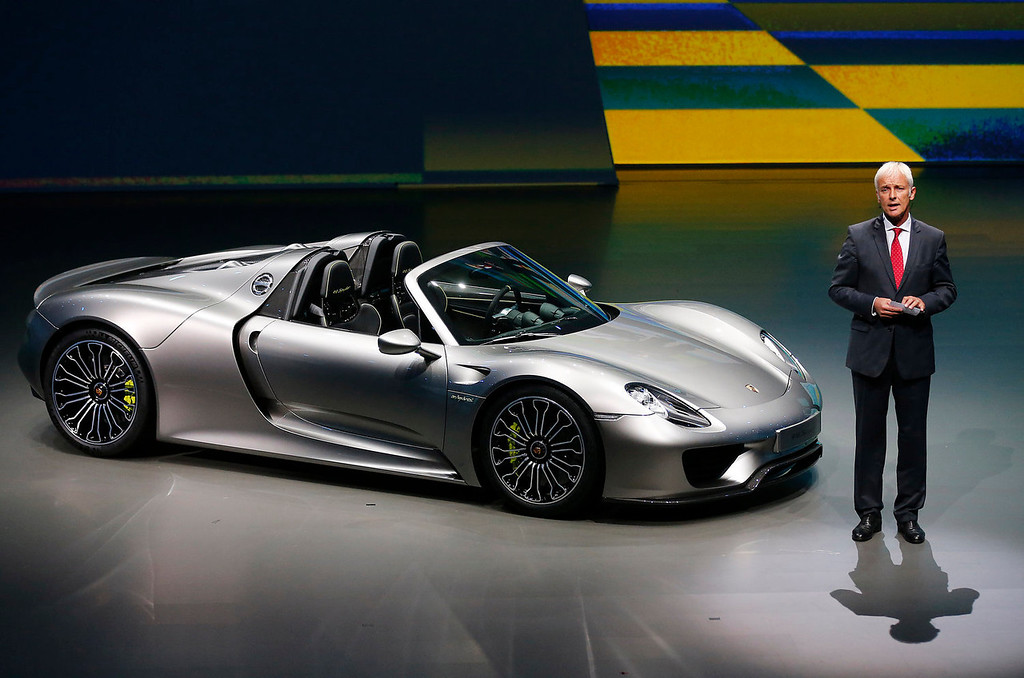 . Porsche AG CEO Matthias Mueller presents the new Porsche 918 Spyder during a preview by the Volkswagen Group prior to the 65th Frankfurt Auto Show in Frankfurt, Germany, Monday, Sept. 9, 2013. More than 1,000 exhibitors will show their products to the public from Sept. 12 through Sept.22, 2013. (AP Photo/Frank Augstein)