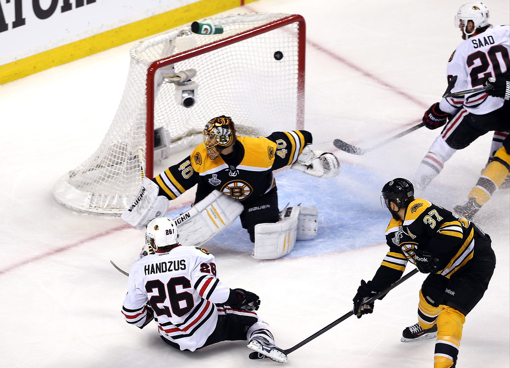 . Michal Handzus #26 of the Chicago Blackhawks scores a goal in the first period against Tuukka Rask #40 of the Boston Bruins in Game Four of the 2013 NHL Stanley Cup Final at TD Garden on June 19, 2013 in Boston, Massachusetts.  (Photo by Bruce Bennett/Getty Images)