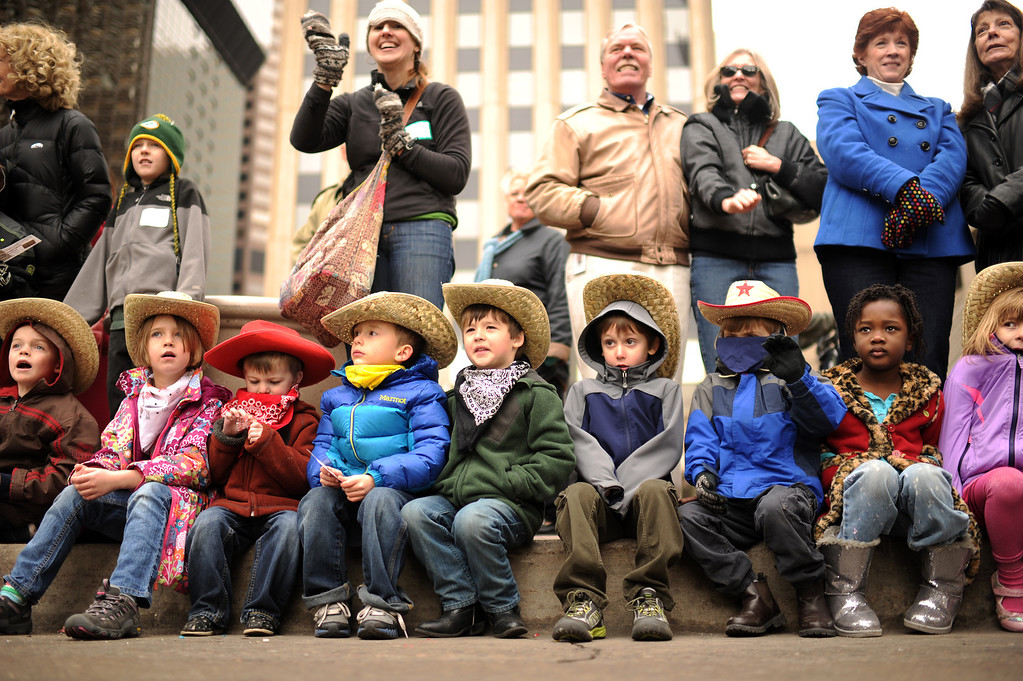 . kindergarteners from Polaris Elementary School are watching the 107th National Western Stock Show Kick-Off Parade at Downtown Denver on Thursday, Denver. CO, January 10, 2013.  Hyoung Chang, The Denver Post