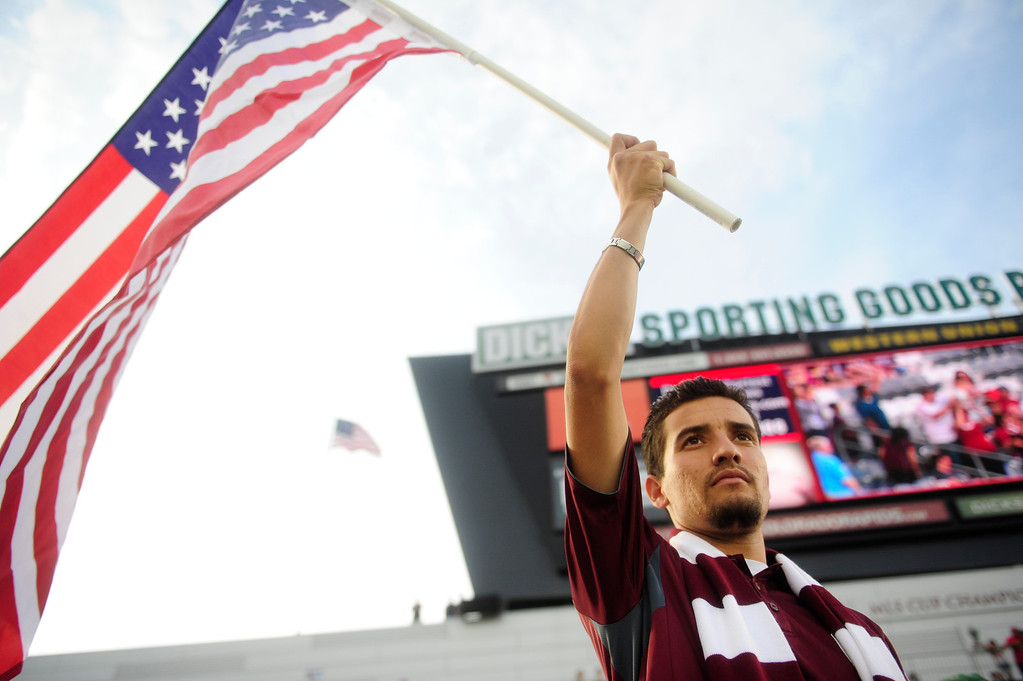 . DENVER - JULY 4:  Luis Guigon, 26, waves the American flag before the first half of a MLS soccer match between the Colorado Rapids and the New York Red Bulls on July 4, 2013 at Dick\'s Sporting Goods Park. The Rapids defeated the Red Bulls 2-0. (Photo By Grant Hindsley / The Denver Post)