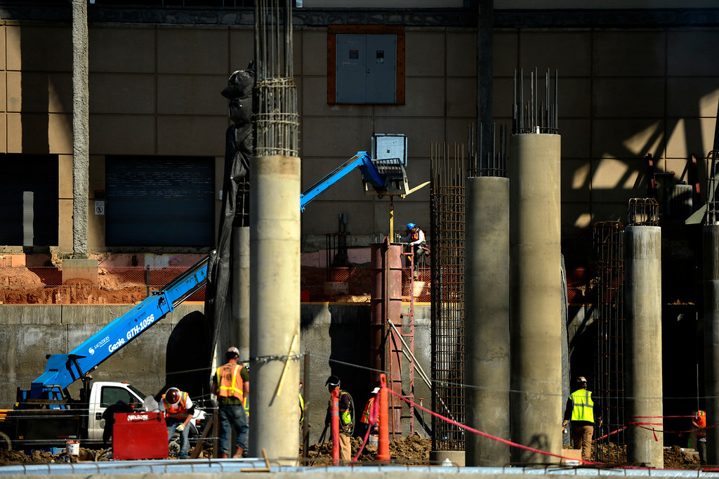 . Construction workers building forms at the Denver International Airport South Terminal Redevelopment Program that is now starting to build vertical for the train station and the Westin Hotel and conference center. Colorado. (Photo By Joe Amon/The Denver Post)