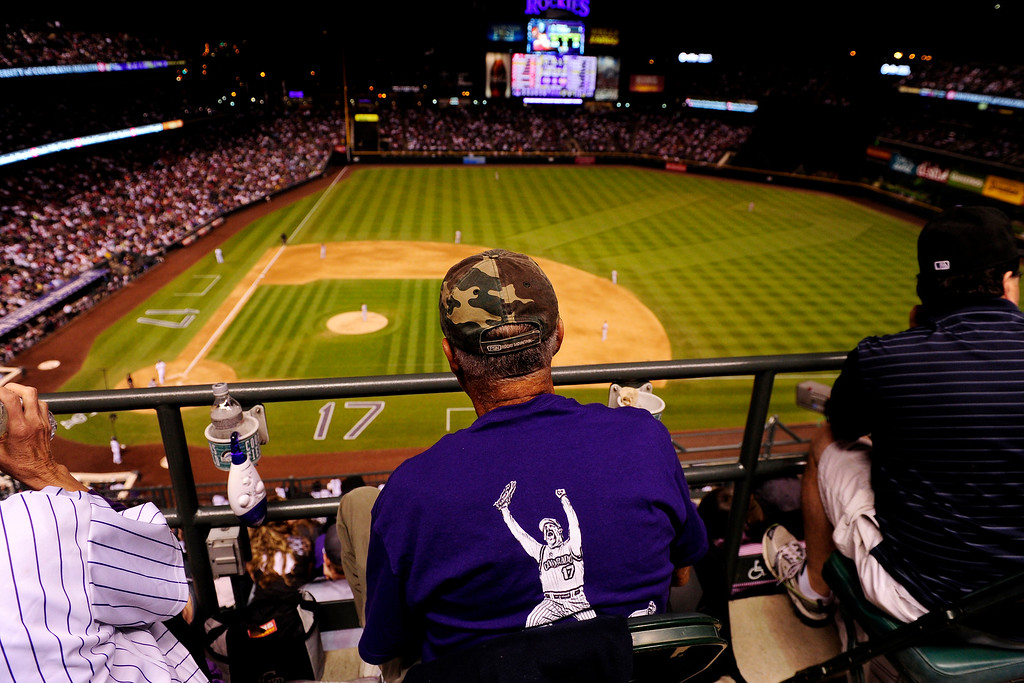 . Fans await the seventh-inning at-bat of Todd Helton (17) of the Colorado Rockies against the Boston Red Sox during the action in Denver. The Colorado Rockies hosted the Boston Red Sox and said farewell to longtime first baseman Todd Helton, who recently announced his retirement following this season. (Photo by AAron Ontiveroz/The Denver Post)