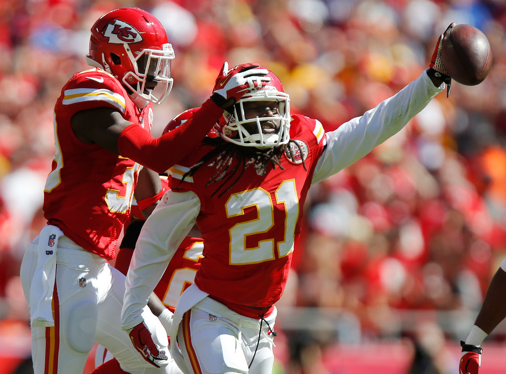 . Kansas City Chiefs cornerback Dunta Robinson (21) celebrates a fumble recovery with defensive back Husain Abdullah (39) during the first half of an NFL football game against the New York Giants at Arrowhead Stadium in Kansas City, Mo., Sunday, Sept. 29, 2013. (AP Photo/Ed Zurga)