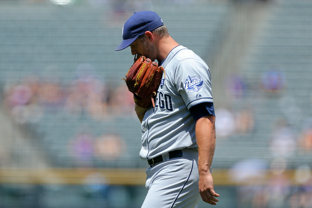 . DENVER, CO - JULY 9:  Starting pitcher Eric Stults #53 of the San Diego Padres walks off the field after giving up two home runs during the first inning against the Colorado Rockies at Coors Field on July 9, 2014 in Denver, Colorado. (Photo by Justin Edmonds/Getty Images)
