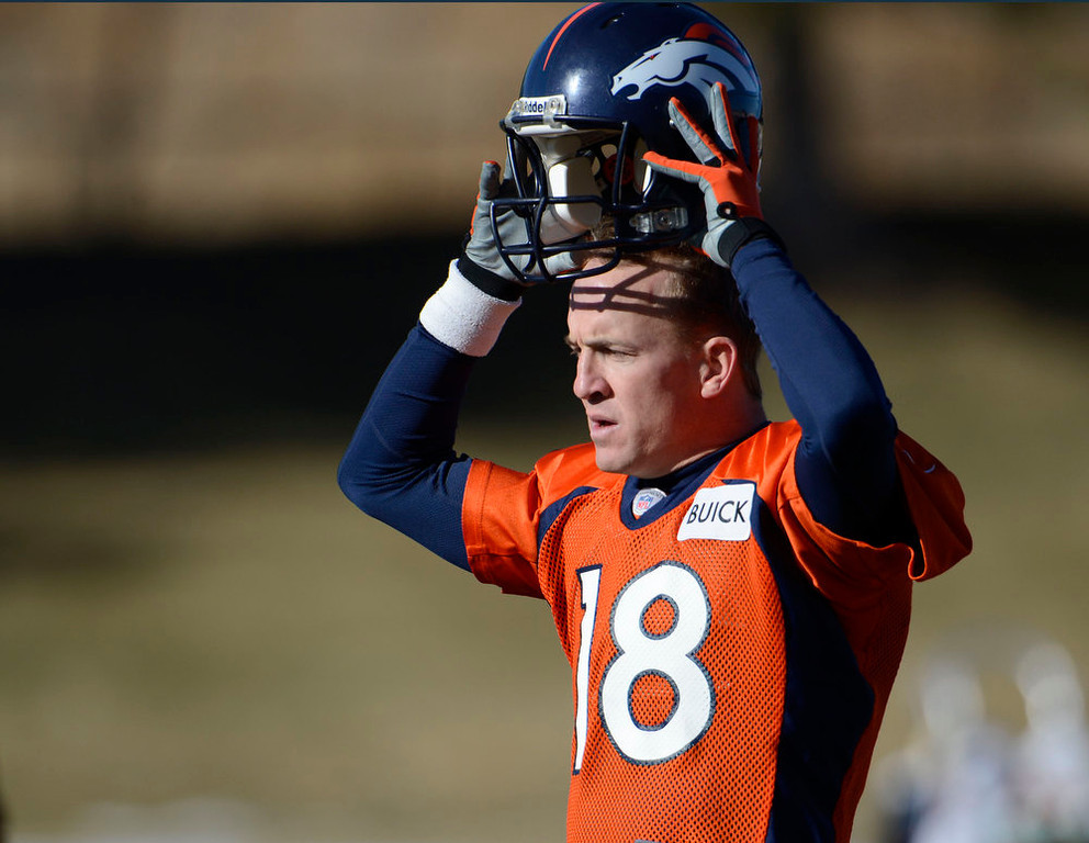 . Denver Broncos quarterback Peyton Manning (18) takes his helmet off for stretching during practice Wednesday, January 9, 2013 at Dove Valley.  John Leyba, The Denver Post