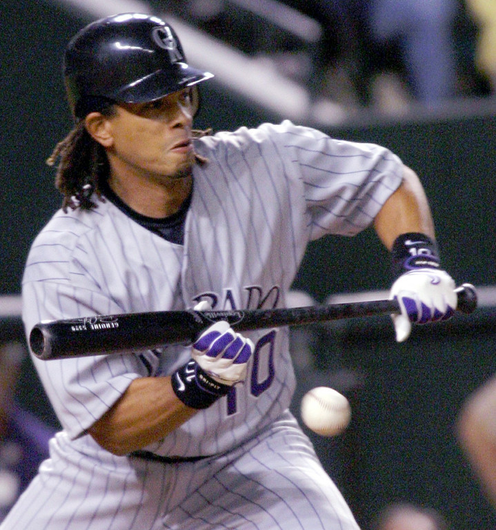 . ROYCE CLAYTON -- Colorado Rockies\' Royce Clayton lays down a sacrifice bunt during the third inning against the Arizona Diamondbacks on April 7, 2004, in Phoenix.(AP Photo/Roy Dabner)