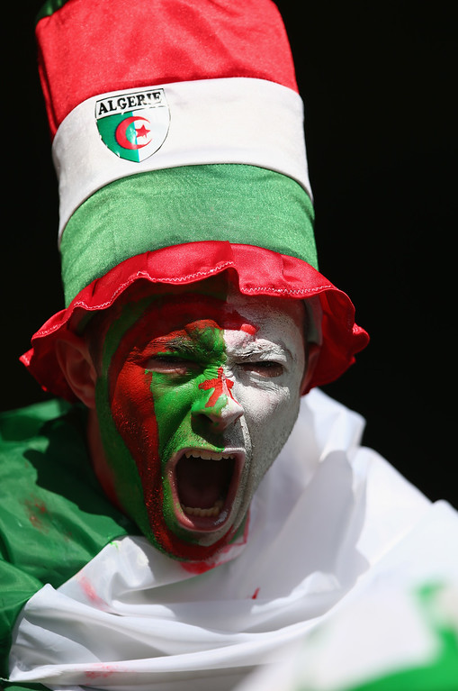 . An Algeria fan cheers prior to the 2014 FIFA World Cup Brazil Group H match between Belgium and Algeria at Estadio Mineirao on June 17, 2014 in Belo Horizonte, Brazil.  (Photo by Paul Gilham/Getty Images)
