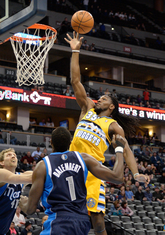. Denver Nuggets power forward Kenneth Faried (35) goes up for a shot over Dallas Mavericks center Samuel Dalembert (1) during the first quarter March 5, 2014 at Pepsi Center. (Photo by John Leyba/The Denver Post)