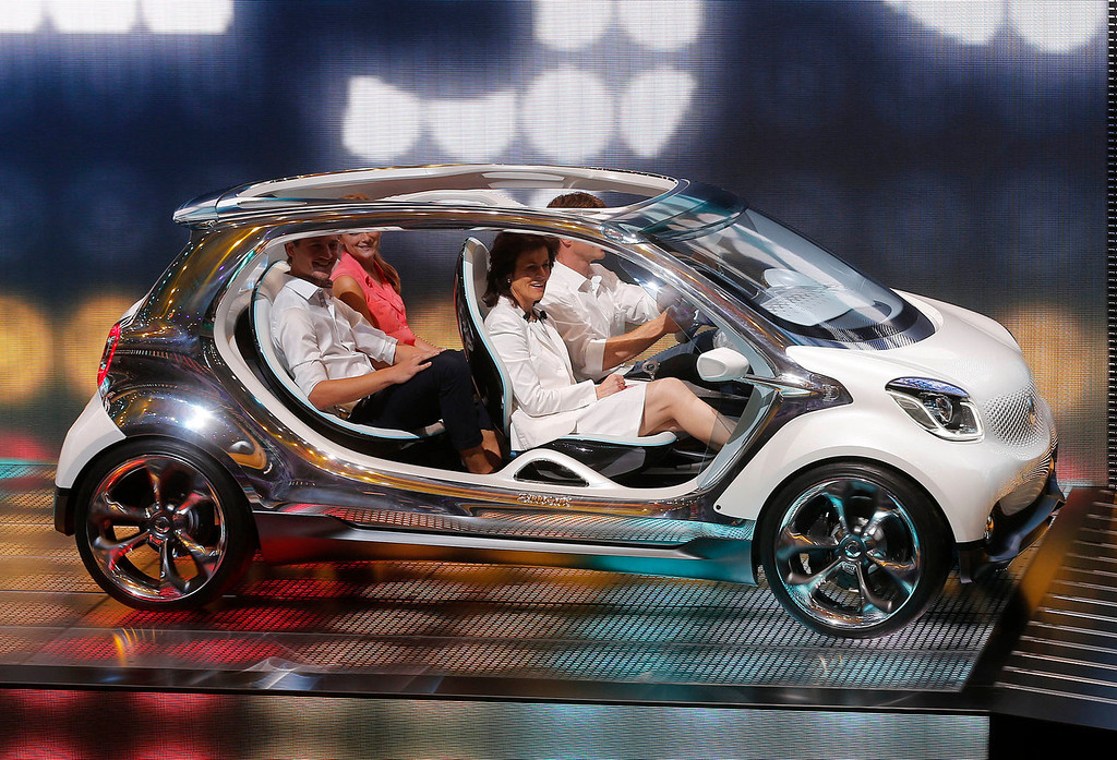 """. The Smart \""""fourjoy\"""" concept car is presented during the Mercedes-Benz/ Smart Media Night the 65th Frankfurt Auto Show in Frankfurt, Germany, Monday, Sept. 9, 2013. More than 1,000 exhibitors will show their products to the public from Sept. 12 through Sept. 22, 2013. (AP Photo/Michael Probst)"""
